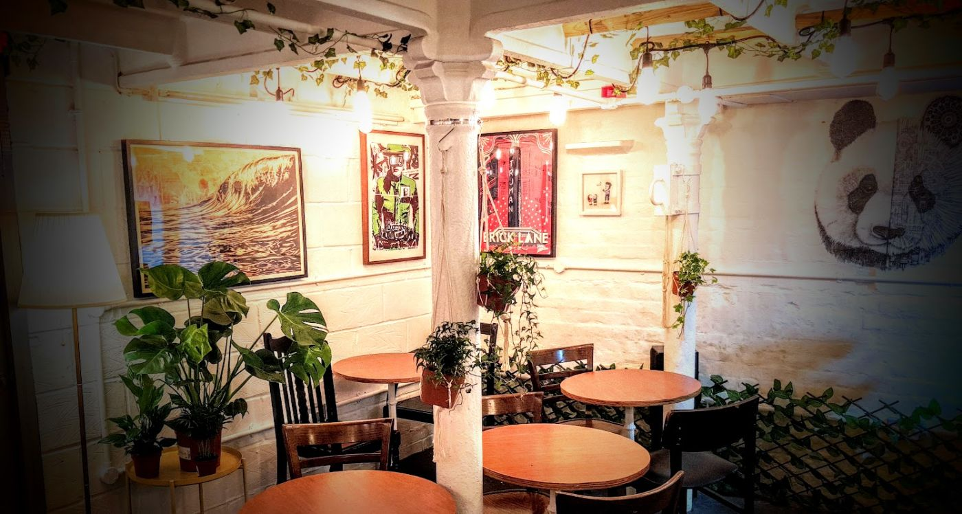 Some of our art by Dran, Bast, Shepard Fairey and Ardif at the Long and Short cafe in Brick Lane